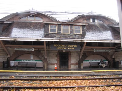 the station at Newton Center in the rain