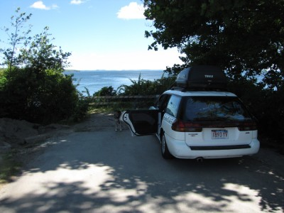 the car parked at a dead-end facing the ocean