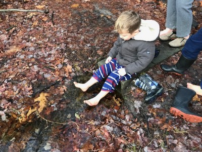 Lijah dipping his feet in a tiny stream