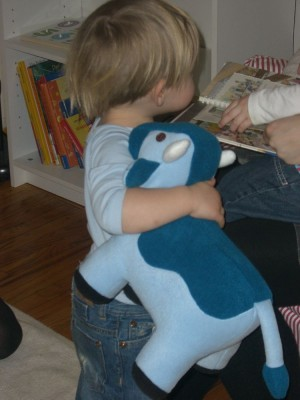 noah hugging his new cow