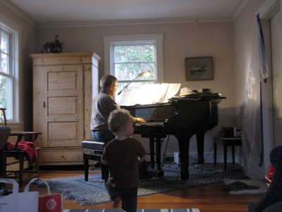 Grandpa playing the piano, Lijah dancing along