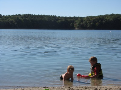 Harvey and Lijah in the water at Walden Pond