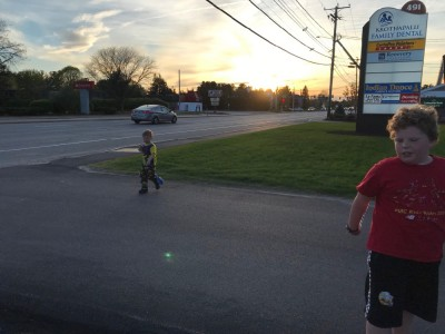 the boys walking along a Nashua highway at sunset