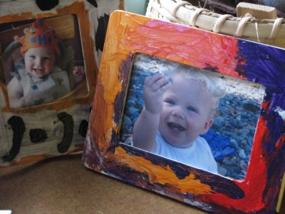 baby Harvey and Zion smiling from the frames the big boys decorated
