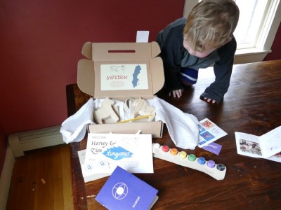 Lijah looking into the craft kit box