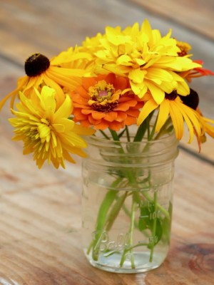 yellow and orange flowers in a jar