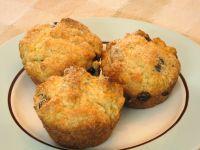 three orange chocolate chip muffins