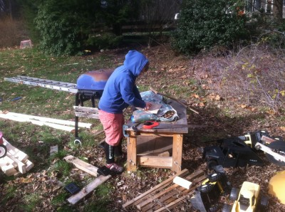 Harvey working on a woodworking project in the messy corner of our yard