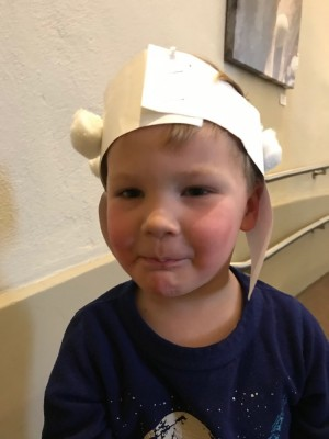 Lijah in a paper and cotton-ball sheep hat