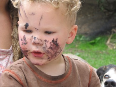 Lijah with paint all over his face