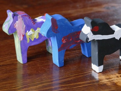 three painted wood horses