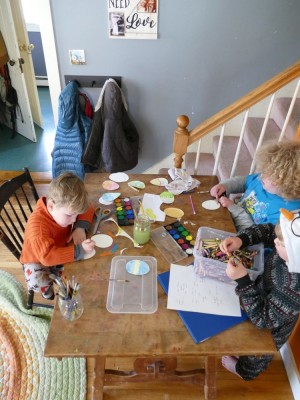 the boys creating paper easter eggs