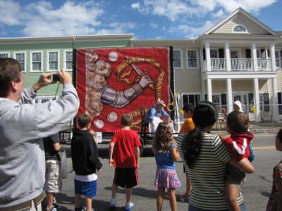 a float featuring the Bedford flag