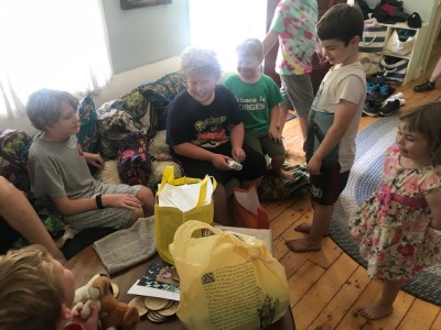 kids watching Harvey opening presents