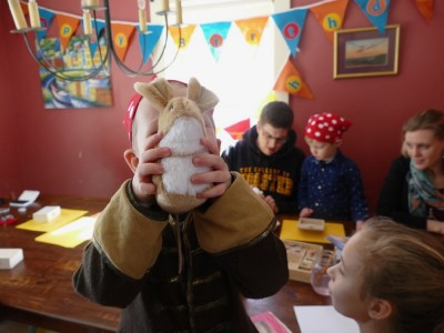 Lijah showing off a new stuffed mouse at his birthday party