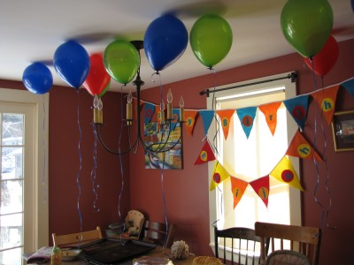 balloons and banners for Lijah's birthday