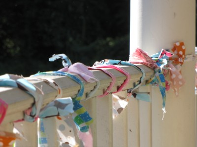 colorful fabric wrapped around the porch railing