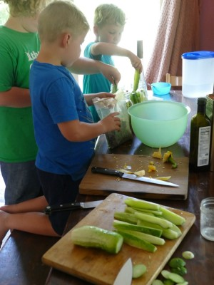 the boys making pickles at the kitchen table