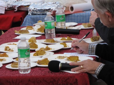 many pieces of pumpkin pie in front of the judges