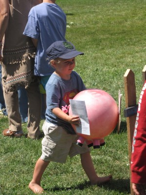 Zion carrying a pink pig ball