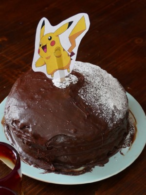 a chocolate cake with a pikachu on top