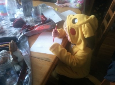 Lijah wearing a pikachu costume drawing