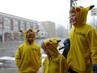 the boys, all in pikachu sweatshirts, in snowy Arlington