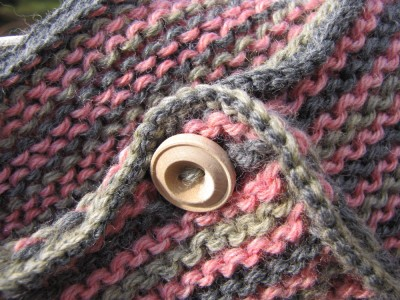 close-up of the pink and gray and green sweater