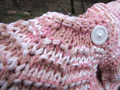 close-up of the pink sweater
