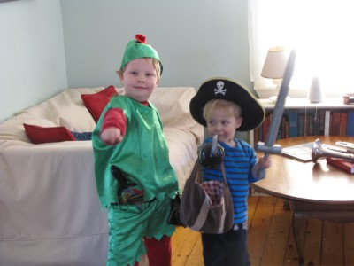 the boys posing in the living room: Harvey dressed as Peter Pan and Zion as a pirate