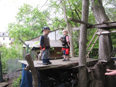 Zion and Lijah in pirate garb on one of the woods platforms