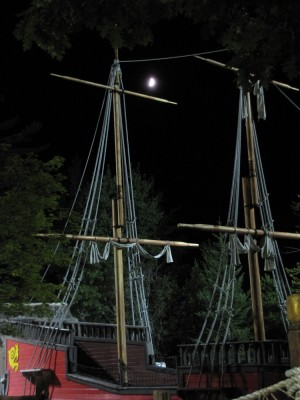 the moon over the rigging of the golf course pirate ship