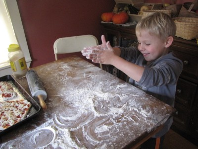 Zion playing with flour