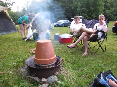 a terra-cotta pot inverted above the campfire