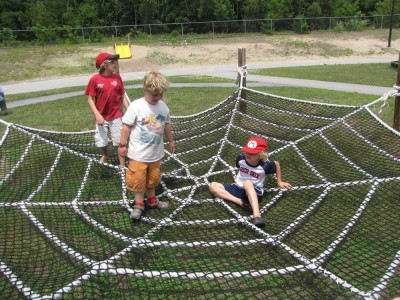 Harvey and friends on a plaground spider web