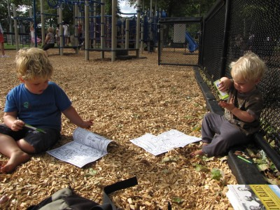 Harvey and Zion drawing in the playground