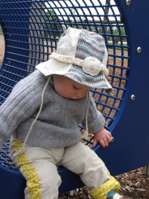 harvey plays on the playground with his new hat