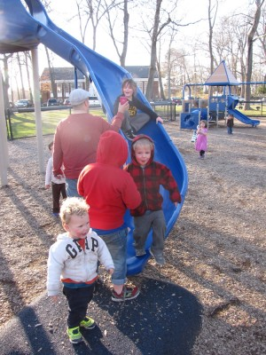 the boys by the slide at the playground