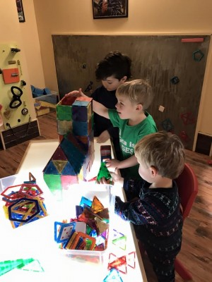 Zion, Lijah, and Julen building at Learning Express