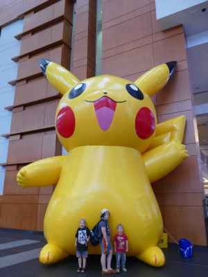 the boys posing in front of a gigantic inflatable Pikachu