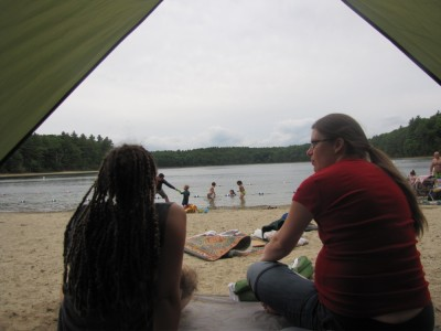 a view of Walden Pond under stormy skies from inside our beach tent