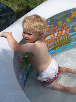 Zion clinging to the side of the inflatable wading pool