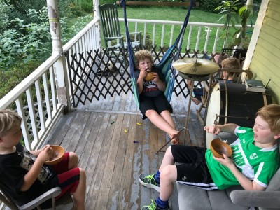 the boys and Nathan eating ice cream on the porch