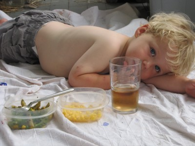 shirtless Zion lying on the blanket with his food