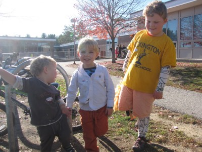 the boys posing outside the polling place with their stickers on