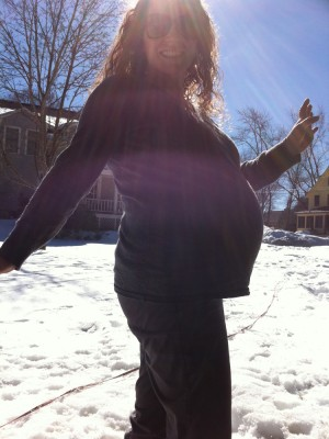 Leah and her belly silhouetted by the winter sun