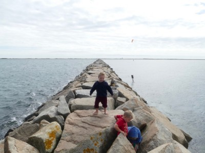 the boys braving the wind on the breakwater in Provincetown
