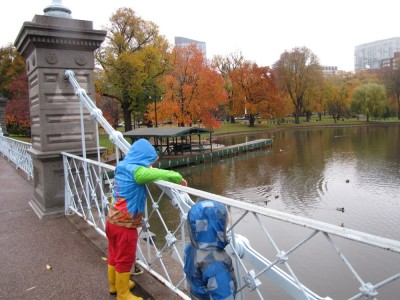 Harvey and Zion looking over the bridge railing at the duck pond