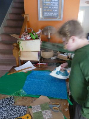 Harvey ironing as he works on a quilt