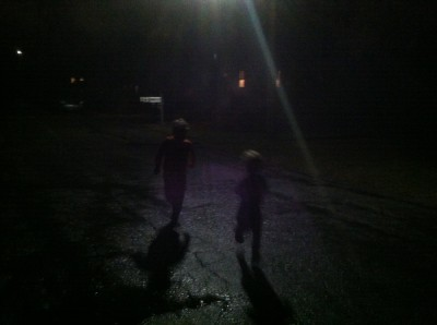 very dark: Harvey and Zion, in swimsuits, running in the rain at night